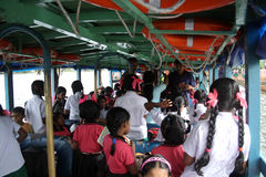 School children travel by boat Royalty Free Stock Images