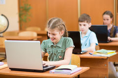 School children using laptop at lesson Stock Photos