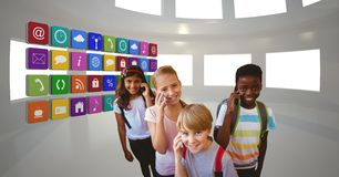 School children using mobile phone by app icons stock photography