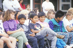 School children watching a procession Royalty Free Stock Photos