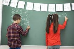 School children writing blackboard Royalty Free Stock Photography