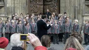 School choir singing Christmas carols in front of Bath Abbey B. Bath, England - Nov 27, 2017: School choir singing Christmas carols in front of Bath Abbey B royalty free stock photo