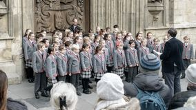 School choir singing Christmas carols in front of Bath Abbey C. Bath, England - Nov 27, 2017: School choir singing Christmas carols in front of Bath Abbey C stock image