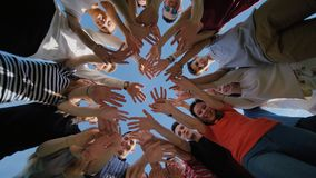 School class collection. The pupils wave their hands and run. College Students Teamwork Stacking Hand Concept. Nineteen. School class collection. The pupils wave stock footage