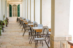 School class, tables and chairs outside in a monastery Royalty Free Stock Photos