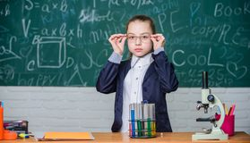 School classes. Observe chemical reactions. Chemical reaction much more exciting than theory. Girl working chemical royalty free stock image