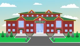 School against the blue sky, with lawn, paths, , fir and fir trees. School, classic brick two-storey building with three entrances and a clock in the center Royalty Free Stock Image