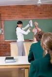 School classroom. Young female teacher teaching biology in school classroom Royalty Free Stock Photo