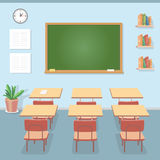 School classroom with chalkboard and desks. Class for education, courses or training Royalty Free Stock Image