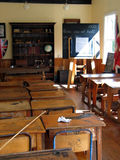 School Classroom Desks. Victorian School Room, Settlers' Village, New Zealand. Focus is on the chair in foreground, background is highly blurred royalty free stock photography
