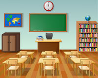 School classroom interior with chalkboard and desk Stock Photos