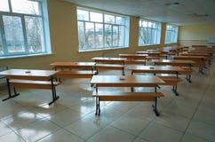 School classroom with school desks and large windows sunny day. Ukraine stock photos