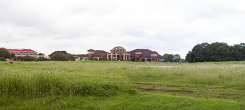 A school clubhouse and a resort. Mango groove surrounded by grassland Royalty Free Stock Photos