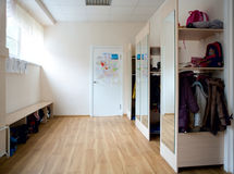 School coatroom. Interior of a school coatroom with racks for coats and storage shelves Royalty Free Stock Photography
