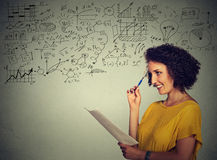 School college teacher standing by the chalkboard during a math science class Royalty Free Stock Images