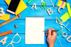 School concept, accessories. the schoolboy points to a notepad. new ideas, homework solution. back to school. place for text. copy. Space Royalty Free Stock Image
