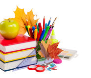 School concept - books, leaves, apple and stationery isolated on Stock Photography