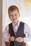 School concept. The boy is going to school. He was buttoning his vest on. royalty free stock photography