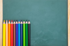 School Concept-Color Pencil on Blackboard background Stock Image
