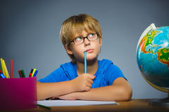 School concept. doubt, expression - boy thinking over gray background Stock Images