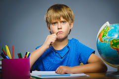 School concept. doubt, expression - boy thinking over gray background Stock Photo