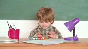 School concept. Elementary school. Kids school. September 1. Little boy in classroom. Education first. Happy mood. Smiling broadly in school stock video