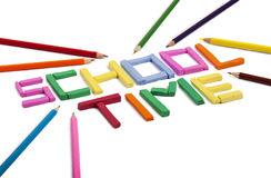 School concept. Plasticine letters and pastel pencils as back to school concept Stock Photos