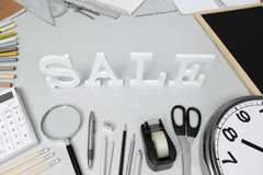 School concept, sale word on the desk with stationery Stock Images