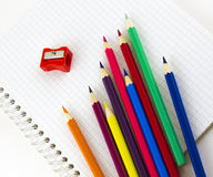 School copybook and pencils Royalty Free Stock Photos