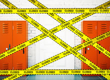 School corridor with closed tape. School corridor interior lockers background with yellow tape and the inscription - closed. Protection crime scene, repairs Royalty Free Stock Image