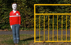 School crossing. Mannequin child preparing to cross a road royalty free stock photos