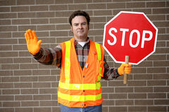 School Crossing Guard. A friendly school crossing guard holding a stop sign royalty free stock photos