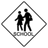 School crossing sign. A white sign marking a children's crossing area Stock Photography