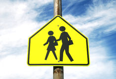 School Crossing Sign and Sky. Crosswalk leading up to an elementary school Royalty Free Stock Photography