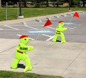 School Crossing Slow Down Zone Warning. Signs with Flags Stock Image