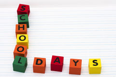 School Days. Alphabet blocks spelling school days on paper stock image