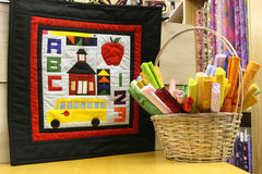 School Days Quilt. With basket of colorful cloth to purchase for quilting stock photos