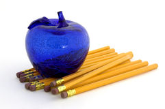School Daze. Macro of a glass apple on a stack of pencils Royalty Free Stock Photos