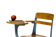 School desk with apple Stock Images