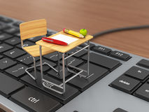 School desk and chair on the keyboard. Royalty Free Stock Photo