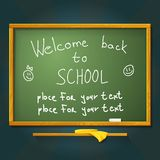 School desk with chalk, welcome back message and Stock Photography
