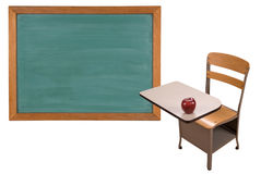 School desk and chalkboard Royalty Free Stock Images