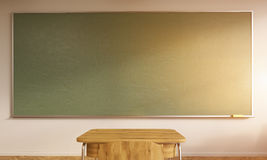 School desk and chalkboard. Classroom interior with sunlight. Large green chalkboard, desk and chair made from wood. Concept of learning new things. Back to Royalty Free Stock Photos