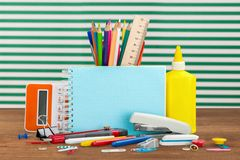 School desk. Closeup isolated document rubber note-book crayons Royalty Free Stock Photos