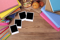 School desk with several blank polaroid style photo album prints stock photos