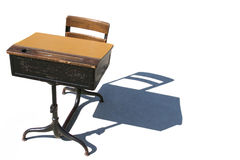 School Desk & Shadow on White. Flip top school desk with long shadow on white background. Horizontal format Stock Image