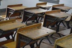 School Desks. An array of old school desks stock photos