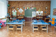 School desks in primary school. Settlement Pervomaisky, Tula region, Russia - SEPTEMBER 20, 2016: School desks in primary school or kindergarten stock image