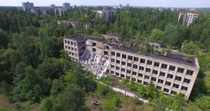 School destroyed in a ghost town. Aerial view. quadrocopters flying near the chool, which was destroyed in 2004 Royalty Free Stock Photos
