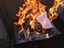 School diary with daily hand written note burning in fire flame royalty free stock photography